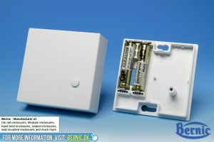 Wall mounted enclosure with batteries